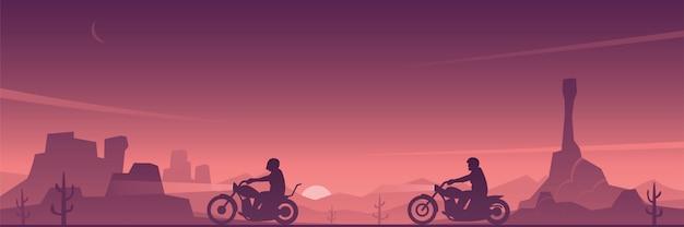 Motorrijders op een woestijnweg