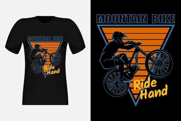 Mountain bike ride hand silhouet vintage t-shirt design