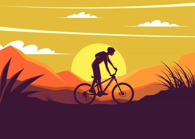 Mountain bike silhoeutte met zonsondergang achtergrond