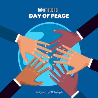 Multiculturele handen verenigd voor de wereld