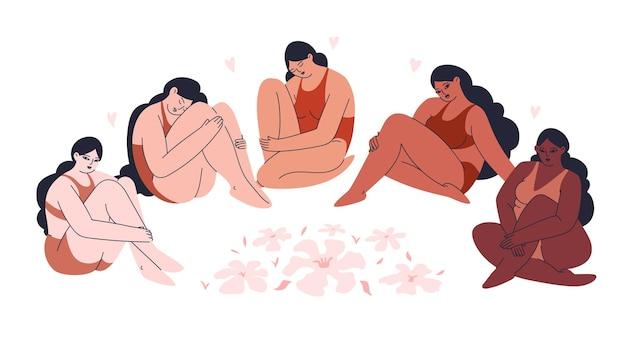 Multiculturele vrouwen in lingerie zitten in een kring tussen bloemen.