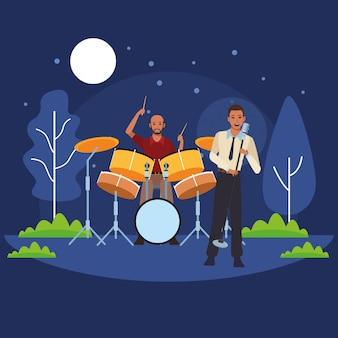 Muzikant speelt drums en zingt