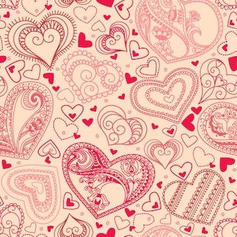 Naadloos behang met handgetekende hartjes