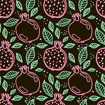 Naadloos decoratief zwart en rood patroon met granaatappels