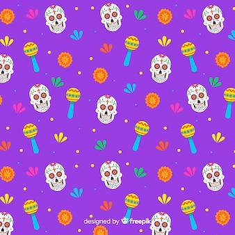 Naadloos dia de muertos-patroon met schedels en maracas