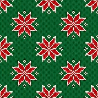 Naadloos gebreid kerstpatroon met sneeuwvlokken