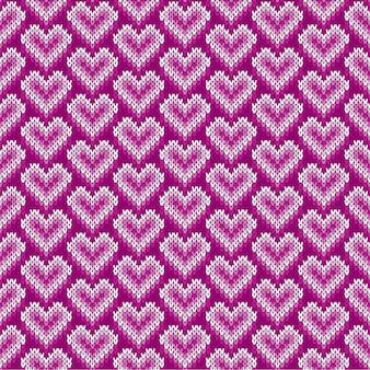 Naadloos gebreide patroon met harten. valentijnsdag achtergrond