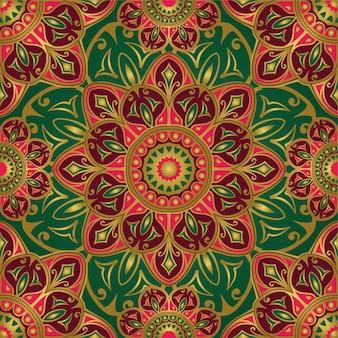 Naadloos groen en roze patroon met mandala's.