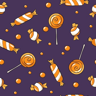 Naadloos halloween-patroon met snoepjes