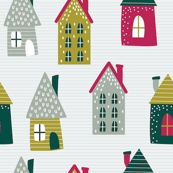 Naadloos kersthuis met rode en groene kleur