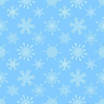 Naadloos kerstmis blauw patroon met getrokken sneeuwvlokken