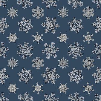 Naadloos kerstpatroon met getrokken sneeuwvlokken
