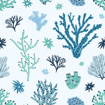 Naadloos patroon met blauwe en groene koralen, zeewier of algen