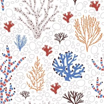 Naadloos patroon met blauwe en rode koralen, zeewier of algen