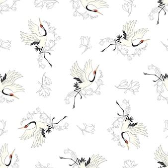 Naadloos patroon met bloemen en witte japanse kraanvogels.