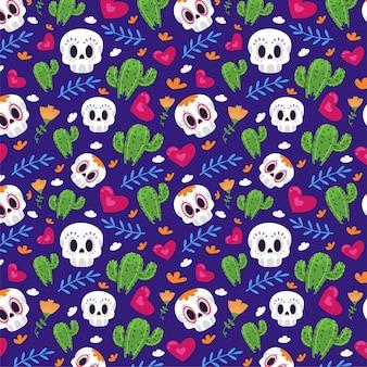 Naadloos patroon met cactussen en schedels