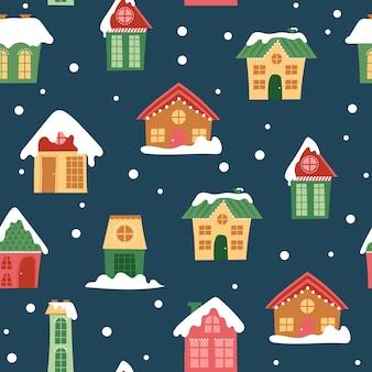 Naadloos patroon met decoratieve kleurrijke huizen in de winter
