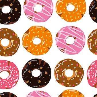 Naadloos patroon met donuts. kleurrijke donuts hand getrokken. pony's met verschillende hagelslag. ontwerp voor verpakking, stof, achtergrond.