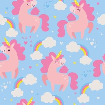 Naadloos patroon met eenhoorns en regenbogen op blauwe achtergrond