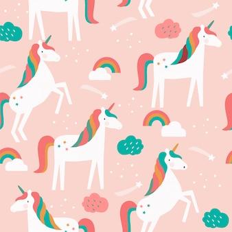 Naadloos patroon met eenhoorns, regenbogen en sterren.