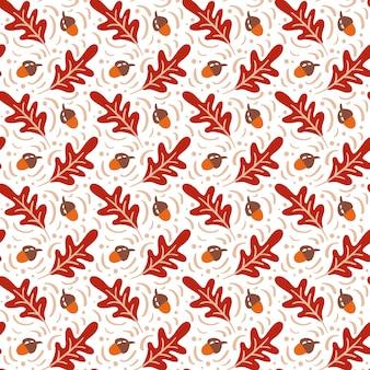 Naadloos patroon met eikels en herfst eikenbladeren in oranje en bruin
