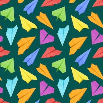 Naadloos patroon met gekleurd papier vliegtuigen