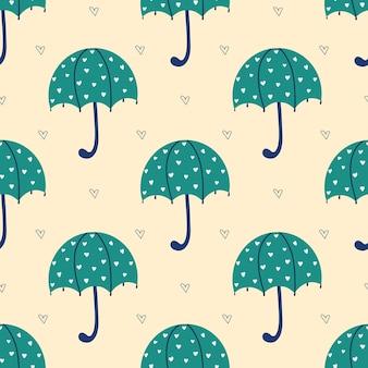 Naadloos patroon met groene paraplu's en harten op een beige herfstpatroon met paraplu