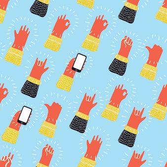 Naadloos patroon met handen die koele rots - en - broodjestekens tonen. hand getekende achtergrond voor uw ontwerp.