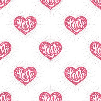 Naadloos patroon met hart en belettering van liefde