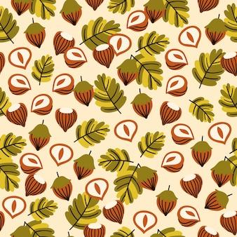 Naadloos patroon met hazelnootbladeren en eikels.