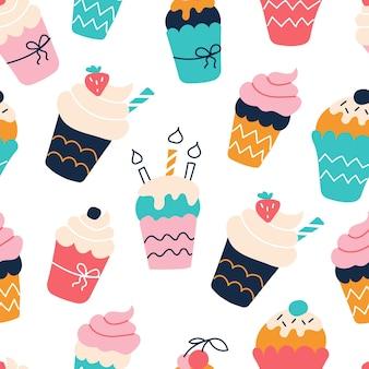 Naadloos patroon met heldere kleurrijke cupcakes in een vlakke stijl