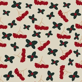 Naadloos patroon met hulstblad en bessen