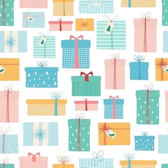 Naadloos patroon met kerstcadeaus