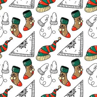 Naadloos patroon met kerstsokken muts en wanten