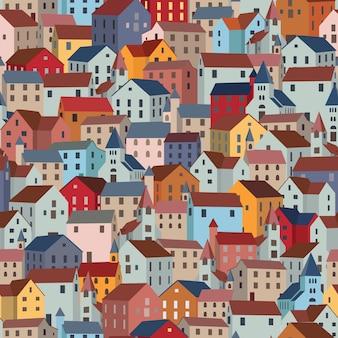 Naadloos patroon met kleurrijke huizen.