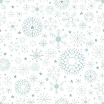 Naadloos patroon met leuke sneeuwvlokken in verschillende maten