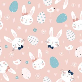 Naadloos patroon met paaseieren en konijnen, bloemen.