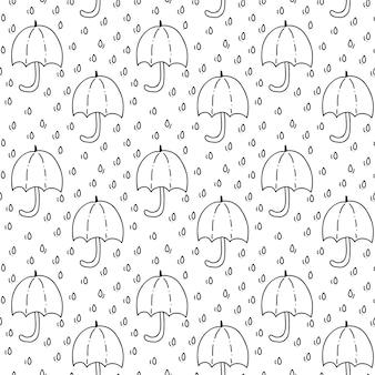 Naadloos patroon met paraplu en druppels regen in het zwart