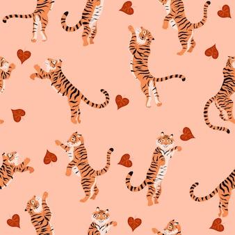 Naadloos patroon met springende tijgers en herfstbladeren