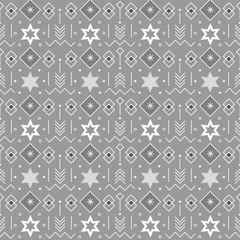 Naadloos patroon met sterren en geometrische elementen op een grijze achtergrond voor kerstthema-ontwerpen