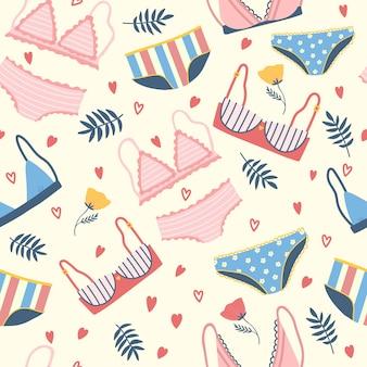 Naadloos patroon met vrouwenlingerie en ondergoed. achtergrond met stijlvolle beha's, slipje en bikini's. hand getekend patroon voor textiel, t-shirt, inpakpapier. leuke vrouwelijke ondergoed set.