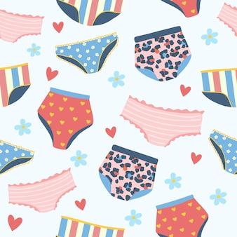 Naadloos patroon met vrouwenlingerie en ondergoed. achtergrond met stijlvolle beha's, slipje en bikini's. hand getekend patroon voor textiel,