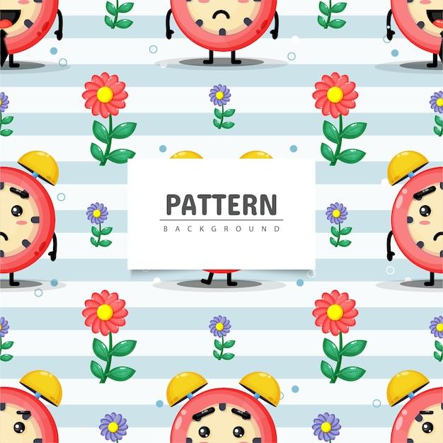Naadloos patroon met wekker en bloem