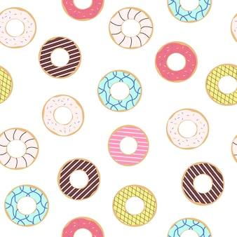 Naadloos patroon van donuts met gekleurd suikerglazuur. trendy mooie donuts witte achtergrond.