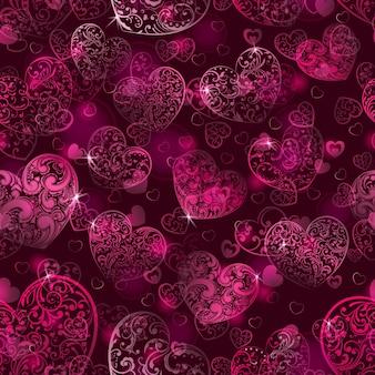 Naadloos patroon van grote en kleine harten met krullen, in donkerroze kleuren