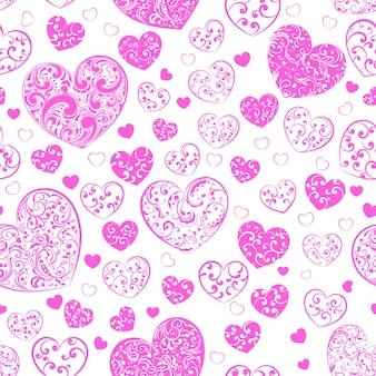 Naadloos patroon van grote en kleine harten met krullen, roze op wit
