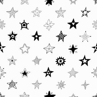 Naadloos patroon van hand getrokken sterren.
