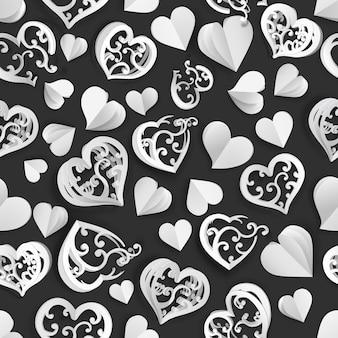 Naadloos patroon van veel papiervolumeharten met gaten en zonder, wit op zwart