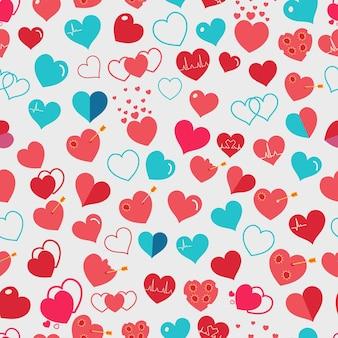 Naadloos patroon van verschillende eenvoudige rode en lichtblauwe harten op witte achtergrond. plat ontwerp
