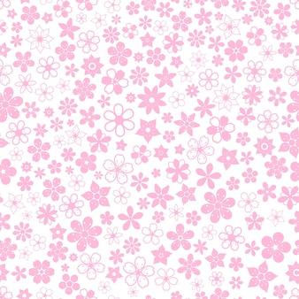 Naadloos patroon van verschillende kleine bloemen in roze kleuren